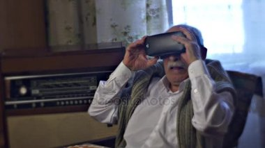 Grandfather at Lunch is Watching 360Vr Video Turning His Head and Wondering Senior Man and Modern Technology Link of Times Two Generations of Entertainment