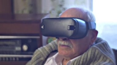 Old Man is Turning Head Watching vr Video Pointing to the Virtual Object and Wondering Modern Technology and Obsolete Interior Radiogram Link of Times