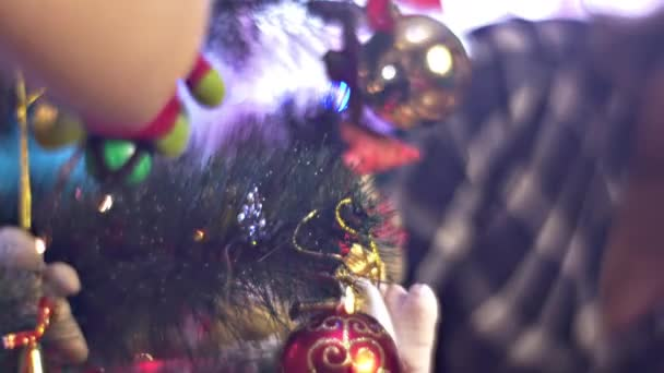 Blonde Woman Mom Decorating New Year Tree Happy Family Celebrate Christmas Holidays at Home Togetherness Vacations Christmas Red and Golden Balls