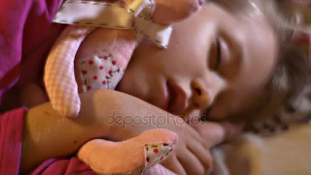 Cute Little Kid is Sleeping Hugs Her Beloved Soft Toys Pink Hand-Made Teddy-Bear and Rabbit Close View Kid Has Been Playing at Home and Fallen Asleep
