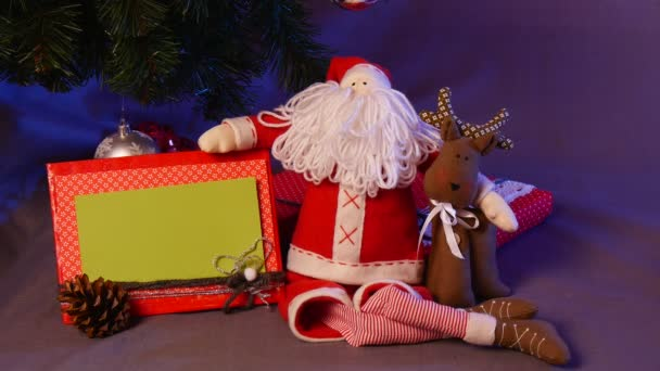 Hand Made Set of Slide Show Cards and Photo Frame Are Taken and Put Back Under a Festive Looking Christmas Tree With a Lot of Funny Toys Under it