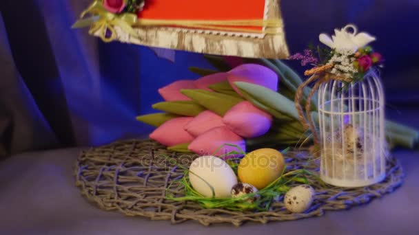 A photo frame and a slide cards set are put on a table with a photo frame and a slide cards set are put on a table with traditional easter gifts such as hen and quail eggs a bunch of rosy tulips and an easter egg negle Gallery