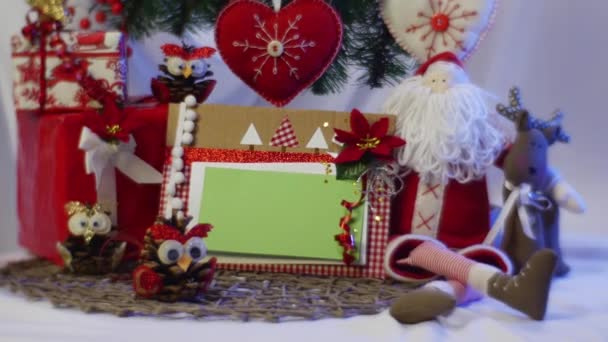 a Festive Box With a Photo Frame is Picked up by a Woman`s Hand From Under a Christmas Fir Tree