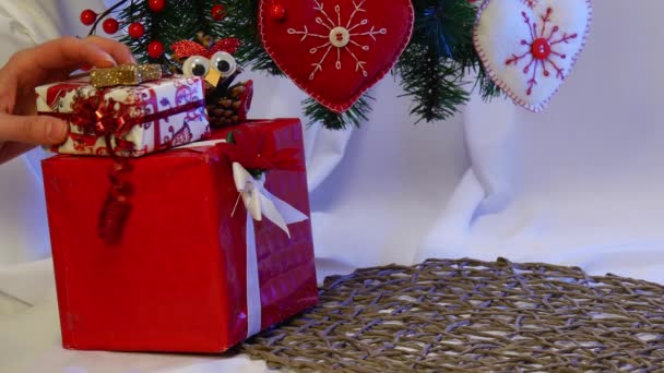 Hand Made Santa Claus is Placed Among Other Hand Made Toys Being Under a Christmas Fir Tree