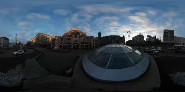 360 vr Video Fountain is Covered Warm Winter Sunset Cars Are Passing by Old Buildings Driven by Road Transportation Traffic Cityscape Blue Sky Cloudscape