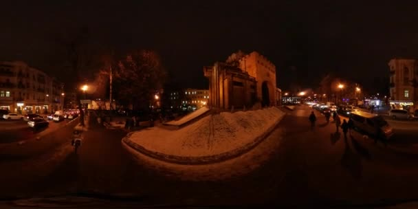 360 vr Video Christmas Eve in Kiev Downtown Golden Gate Street Lamps Lit the Street of Old City Night Cityscape of Kyiv People Are Walking by the Sidewalk