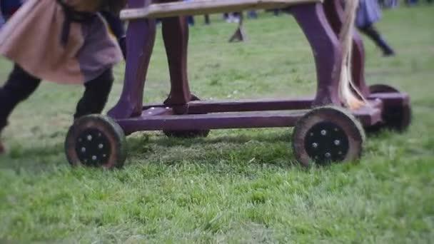 Man Checks a Integrity of a Wooden Horse