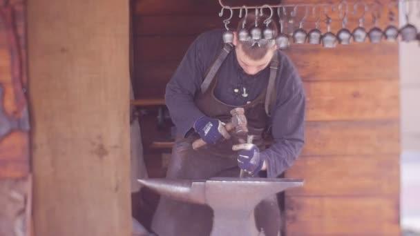 a Smith Makes a Metal Pendant