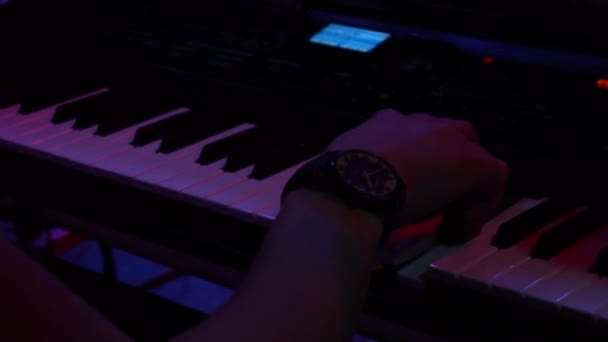 musician playing the electronic piano to a rock concert. Hands of a musician.Synthesizer