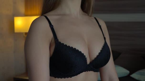Female sexy breasts in a black bra close-up