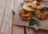 Grilled pineapple slices with addition of honey, top view