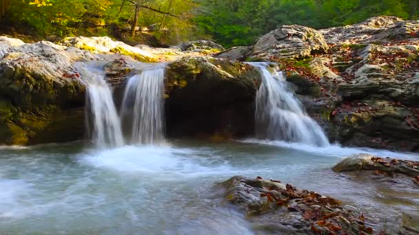 A river flows over rocks in this beautiful scene in the  mountains in autumn cinemagraph