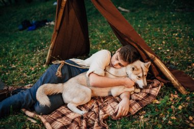 Boy lying with dog