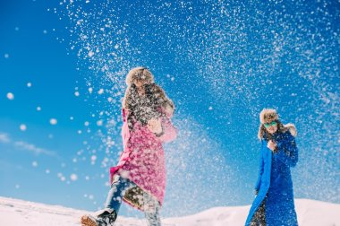 young women in snowy mountains