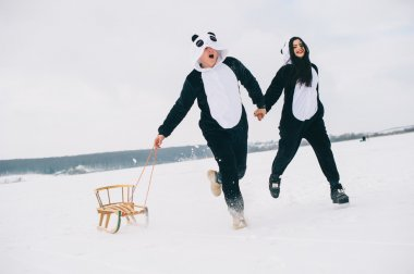 couple in suits of pandas