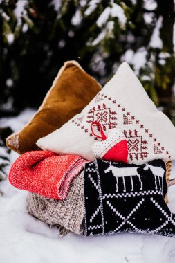 pillows in basket on snow