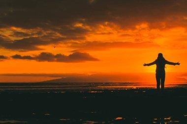 male silhouette at sea