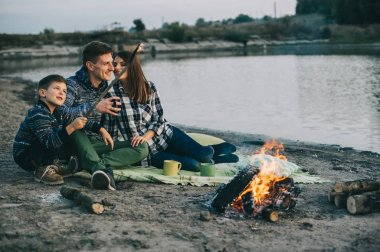 Happy family and campfire