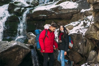 Couple standing on rock