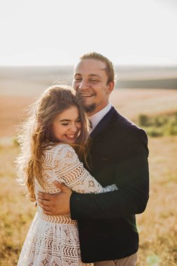 Weeding couple at field