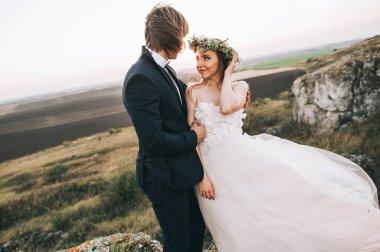 stylish groom and emotional bride