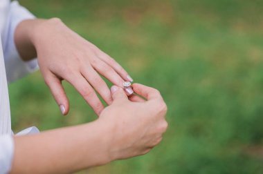 bride hands with awedding ring