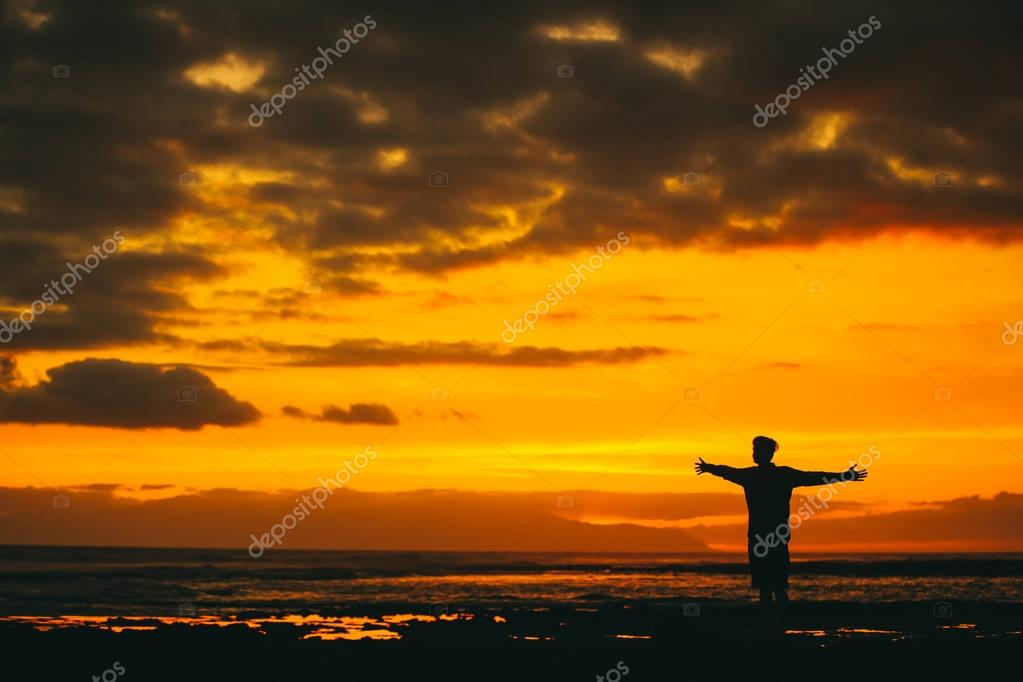silhouette of man at the sea