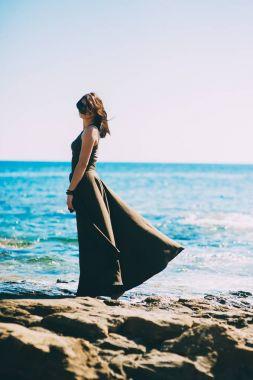 beautiful fashionable model on the beach