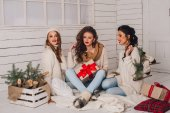 Fotografie girls with gifts for Christmas