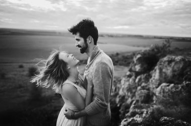 portrait of passionate young couple in the mountains