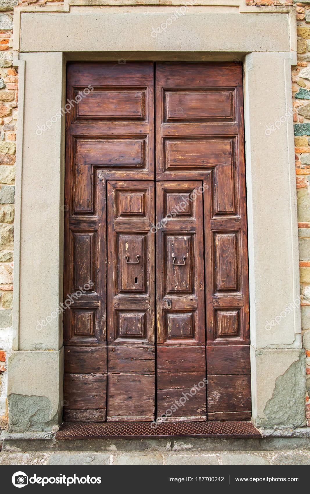 Italian door in small village u2014 Stock Photo & italian door in small village u2014 Stock Photo © sichkarenko_com #187700242