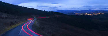 Road with car lights in the direction of the city of San Sebastian (Donostia), Basque Country, Spain