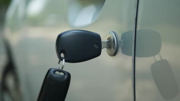 Close Up Car Key Image and Man Hand when Lock the Door