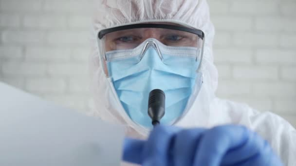 Slow Motion with Medical Specialist Wearing a Protection Suit and Talking in a Medical Press Conference About Coronavirus Epidemic