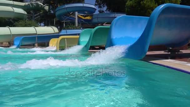 Water slide in aquapark. Slow motion.