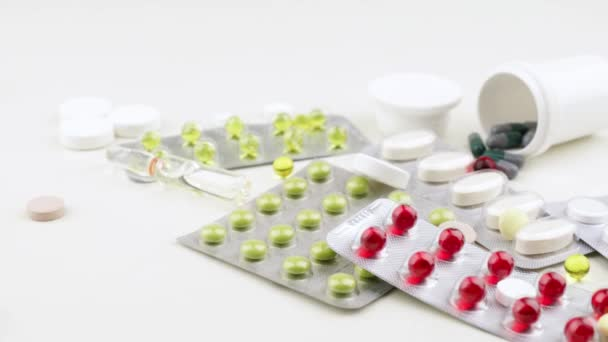 Multi-colored pills and capsules lie on the table. Scattered drugs. Cold and flu season.