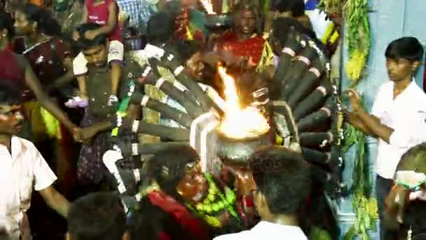KULASEKHARAPATNAM, INDIA - OCTOBER 20, 2014: Devotees dancing in crowd at Hindu festival in Sri Mutharamman Temple at Thoothukudi district,Tamilnadu,India