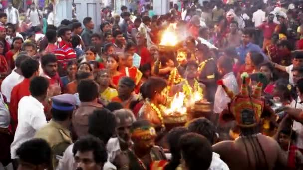 KULASEKHARAPATNAM, INDIA - OCTOBER 20, 2014: Devotees dancing in crowd at Hindu festival in Sri Mutharamman Temple at Thoothukudi district,Tamilnadu,India