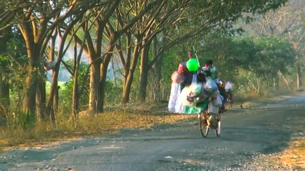 Vendor Man On Bicycle With Carrying Balloons And Handicrafts At A