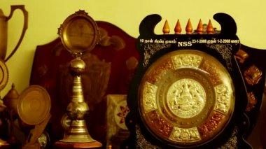 TIRUPPATUR, INDIA - OCTOBER 11th, 2014: Golden Trophy, Close up.