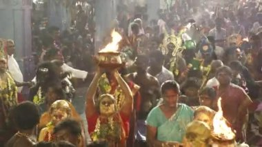 KULASEKHARAPATNAM, INDIA - OCTOBER 20, 2014: Devotees dancing in crowd at Hindu festival in Sri Mutharamman Temple at Thoothukudi district,Tamilnadu,India.