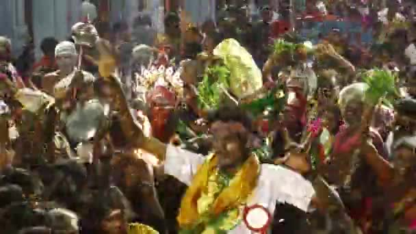 KULASEKHARAPATNAM, INDIA - OCTOBER 20, 2014: Time lapses - Devotees dancing in crowd at Hindu festival in Sri Mutharamman Temple at India.