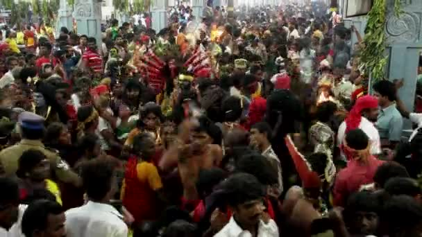 KULASEKHARAPATNAM, INDIA - OCTOBER 20, 2014: Devotees dancing in crowd at Hindu festival in India