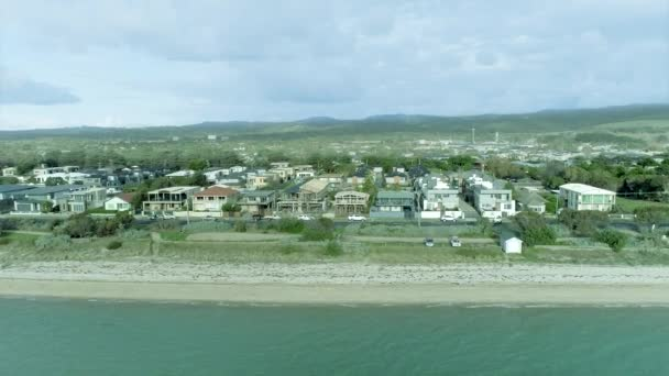 Bird's eye view of Great Ocean Road - Australia, The view of the ocean and the house as the camera moves forward