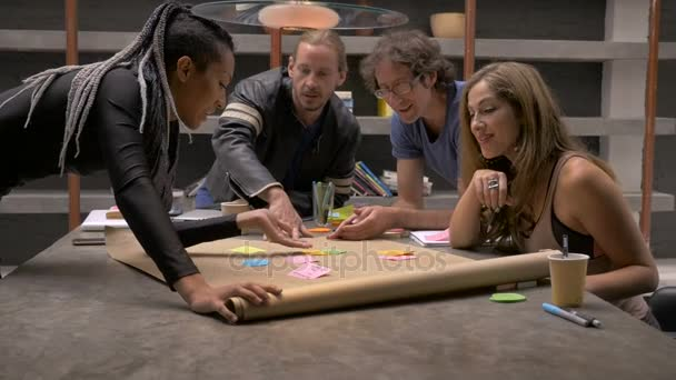 A group of business millennials working together in a co-working space