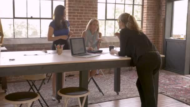 Three creative women artistic entrepreneurs exchanging ideas during startup