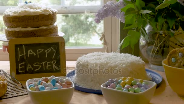 Homemade desserts and a sign that says happy Easter on a small chalk board
