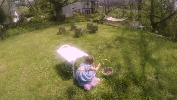 POV of a mother following her young daughter on an Easter egg hunt