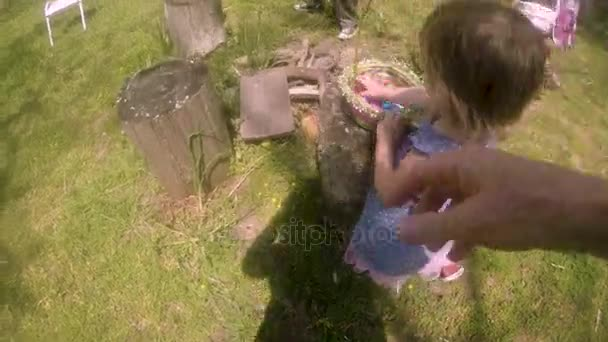 POV of a mother with her daughter and Easter eggs in a basket