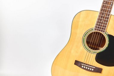 Acoustic guitar isolated on white background .